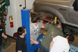 Auto shop group with car on lift SMALL